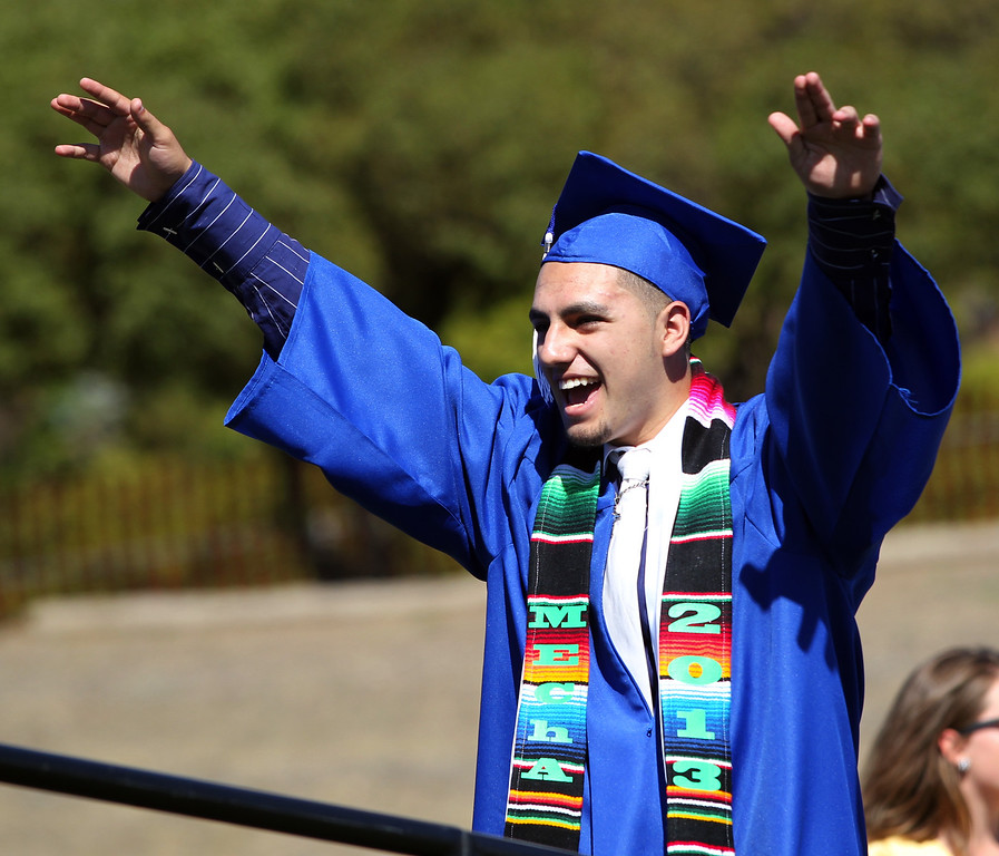 . Christopher Cardona, 18, Irvington High School graduates celebrates before receiving his diploma during their commencement ceremony in Fremont, Calif., on Thursday, June 20, 2013. (Anda Chu/Bay Area News Group)