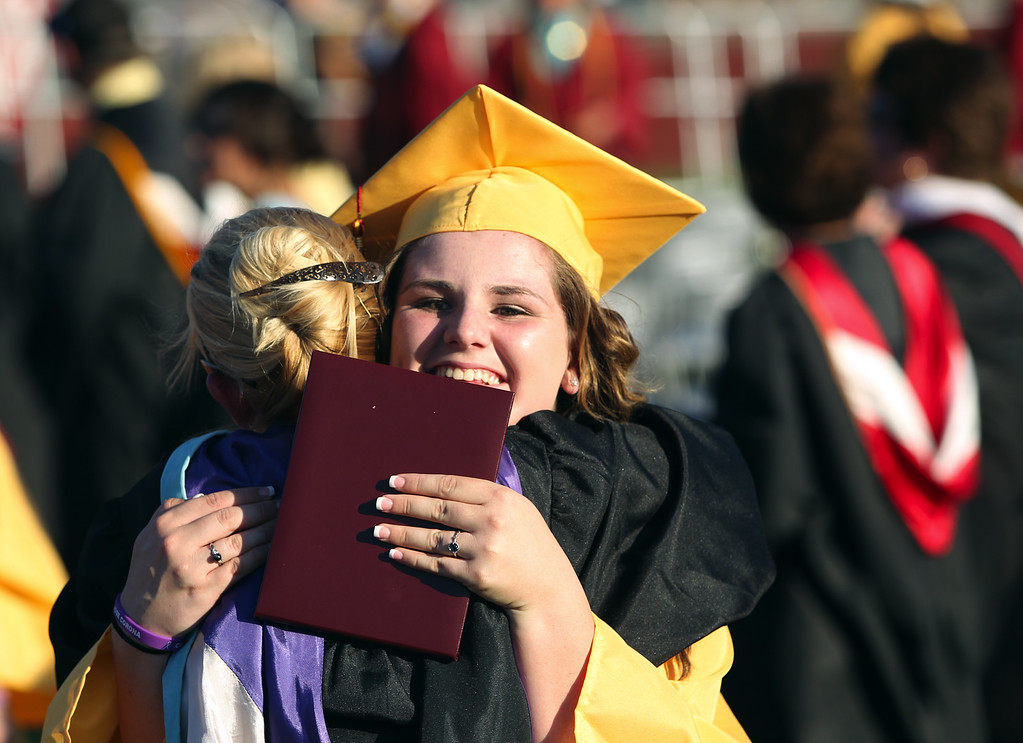 . Kristine Carpenter, 18, hugs teacher Jen Heinz during the Liberty High School Class of 2013 commencement ceremony on the school\'s Ohmstede Field in Brentwood, Calif., on Friday, June 7, 2013. (Anda Chu/Bay Area News Group)