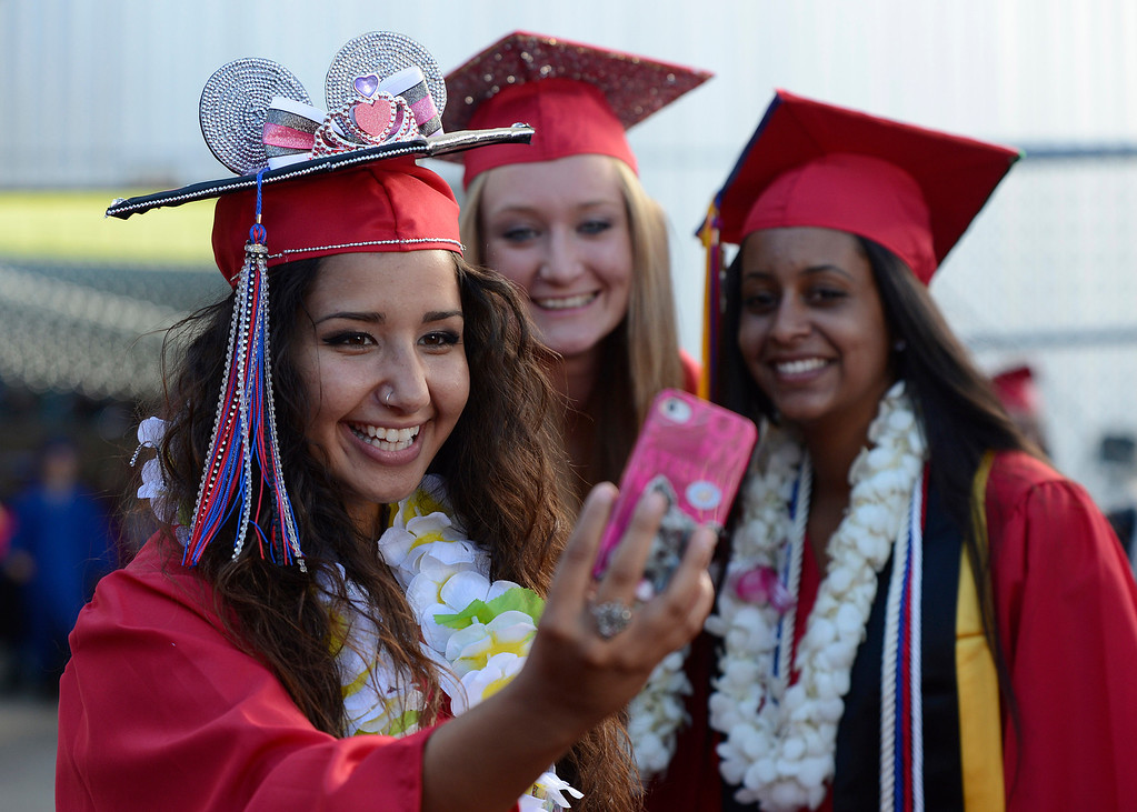 . Clayton Valley Charter High School student Sara Opeyany, 18, takes a picture of herself with classmates Katharina Woeste, 16, from left, and Melay Goitom, 17, before commencement ceremonies on Thursday, May 30, 2013 at Sleep Train Pavilion in Concord, Calif. (Jose Carlos Fajardo/Bay Area News Group)
