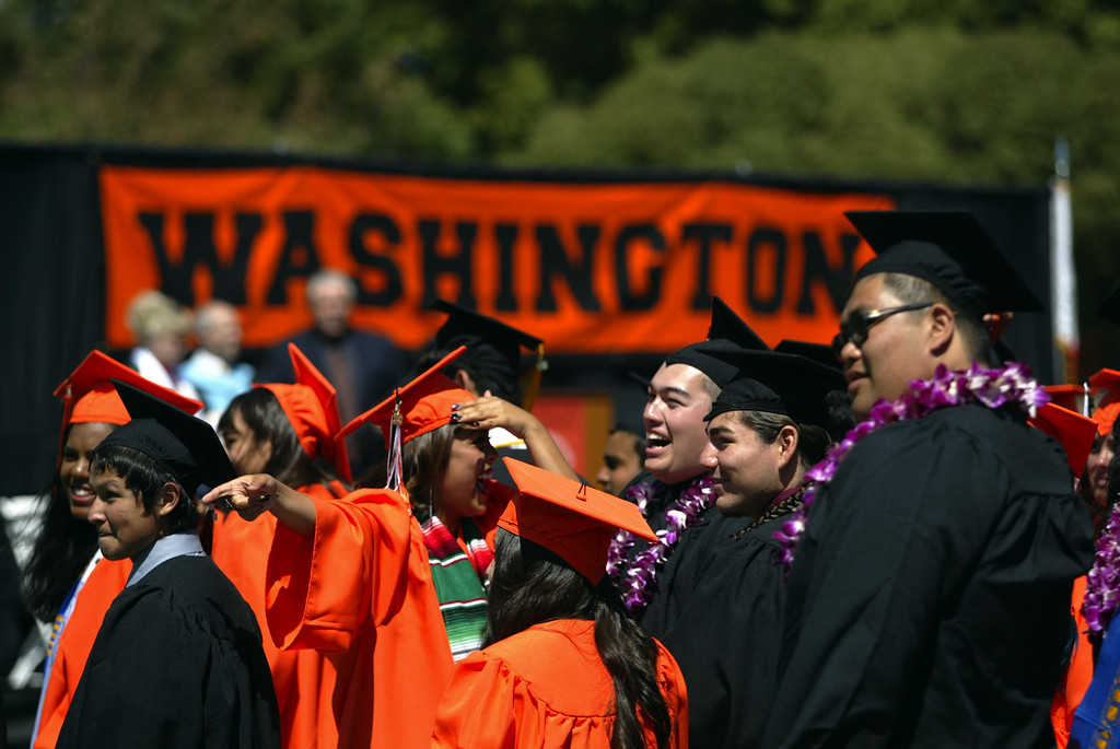 . Washington High School Class of 2013 graduates search for family and friends during their commencement ceremony in Fremont, Calif., on Wednesday, June 19, 2013. (Anda Chu/Bay Area News Group)