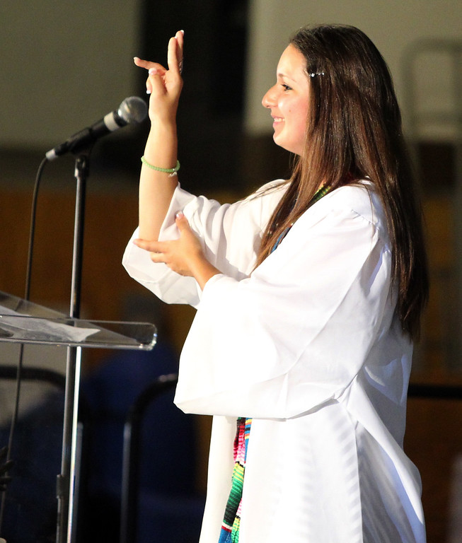 . Class of 2013 graduate and Class Speaker Esperanza Dillard, 18, of Livermore, delivers her speech in American Sign Language during graduation ceremony at the California School for the Deaf in Fremont, Calif., on Friday, June 7, 2013. Forty seniors make up the school\'s 141st CSD graduating class. (Anda Chu/Bay Area News Group)