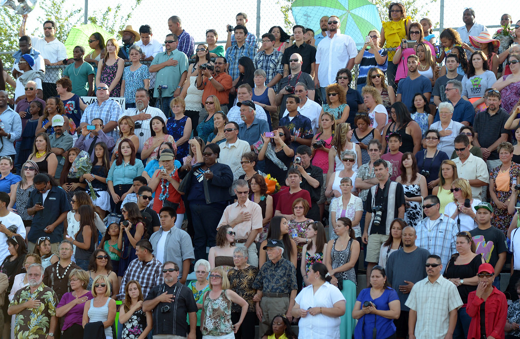 . Friends and family stand during the playing of the national anthem during graduation ceremonies at Deer Valley High School in Antioch, Calif., on Thursday, June 6, 2013. (Jose Carlos Fajardo/Bay Area News Group)