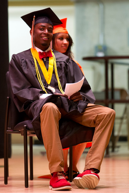 . Salutatorians Quincey Wesley, left, and Danny Sola wait their turns to speak during the graduation ceremonies for the Class of 2013 at McClymonds High School, Thursday, June 13, 2013 in Oakland, Calif. (D. Ross Cameron/Bay Area News Group)