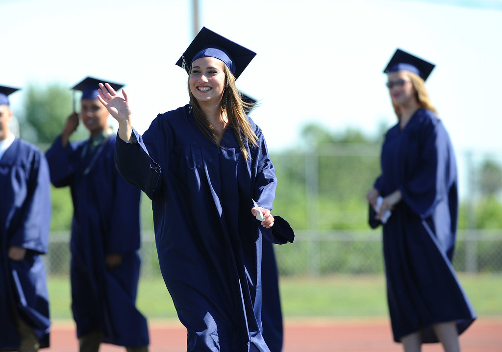 . Deanna Recob waves to family and friends as she marches to her seat at the Freedom High School graduation ceremony held at Falcon Stadium on the campus of Freedom High School in Oakley, Calif., on Saturday, June 8, 2013. (Dan Honda/Bay Area News Group)