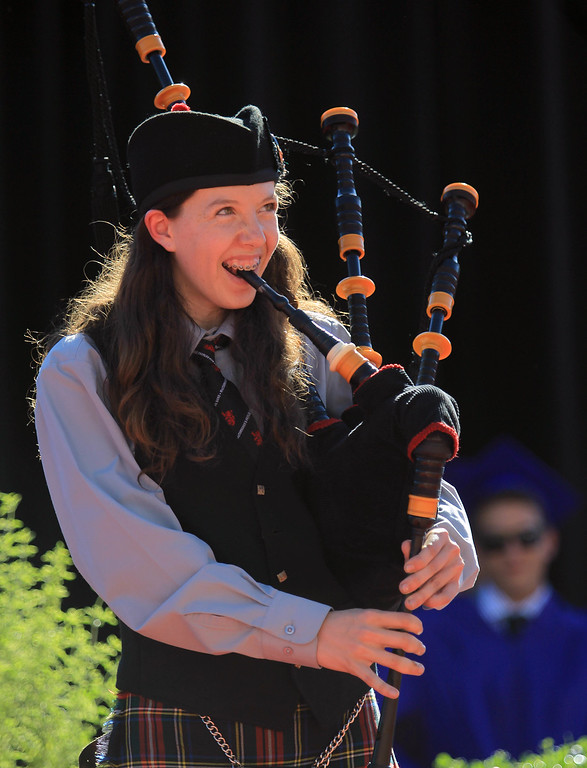 """. Freshman Alexandra Shoptaugh plays \""""Scotland the Brave\"""" on the bagpipes during commencement ceremonies at Piedmont High School in Piedmont, Calif., on Thursday, June 13, 2013.  (Jane Tyska/Bay Area News Group)"""