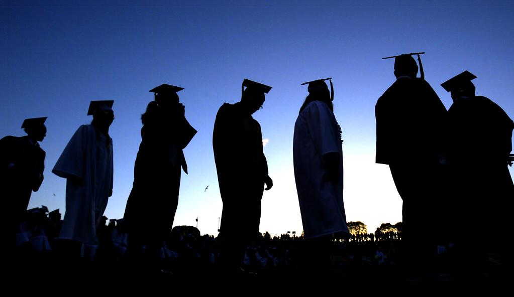 . Kennedy High School graduates line up to receive  their diplomas during the school\'s commencement ceremony in Fremont, Calif., on Wednesday, June 19, 2013. (Anda Chu/Bay Area News Group)