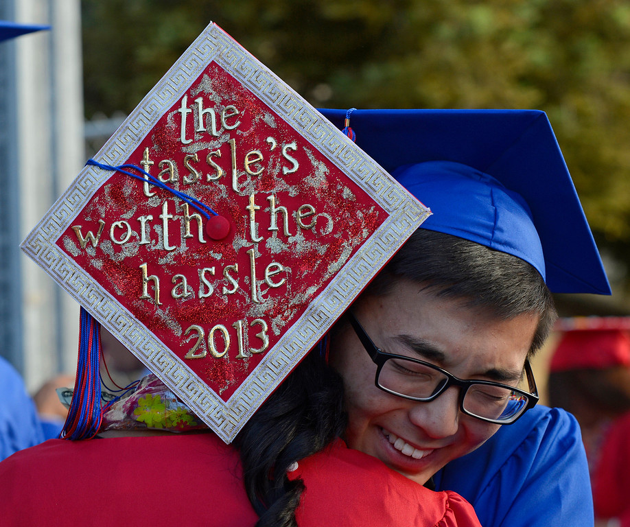 . Clayton Valley Charter High School student Sydney Patton, 17, hugs classmate Steve Noh, 17, during commencement ceremonies on Thursday, May 30, 2013 at Sleep Train Pavilion in Concord, Calif. (Jose Carlos Fajardo/Bay Area News Group)