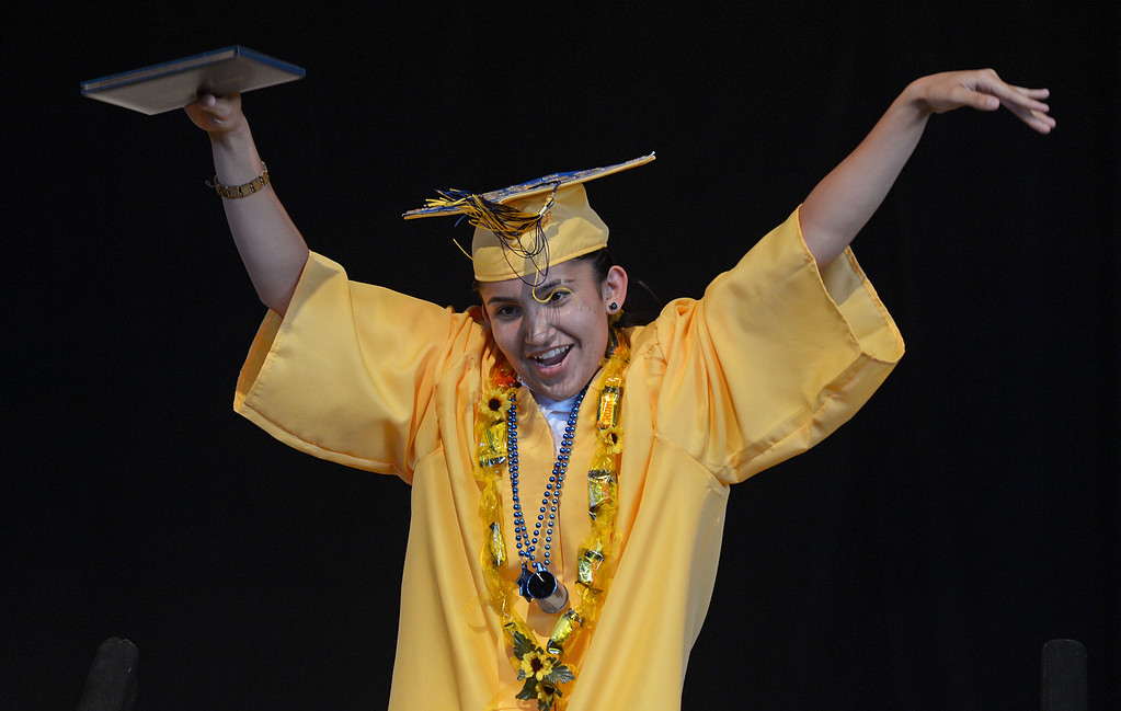 . Ygnacio Valley High School student Daisy Bonilla raises her hands in celebration after receiving her diploma cover during commencement ceremonies at Sleep Train Pavilion in Concord, Calif., on Thursday, June 13, 2013. (Jose Carlos Fajardo/Bay Area News Group)