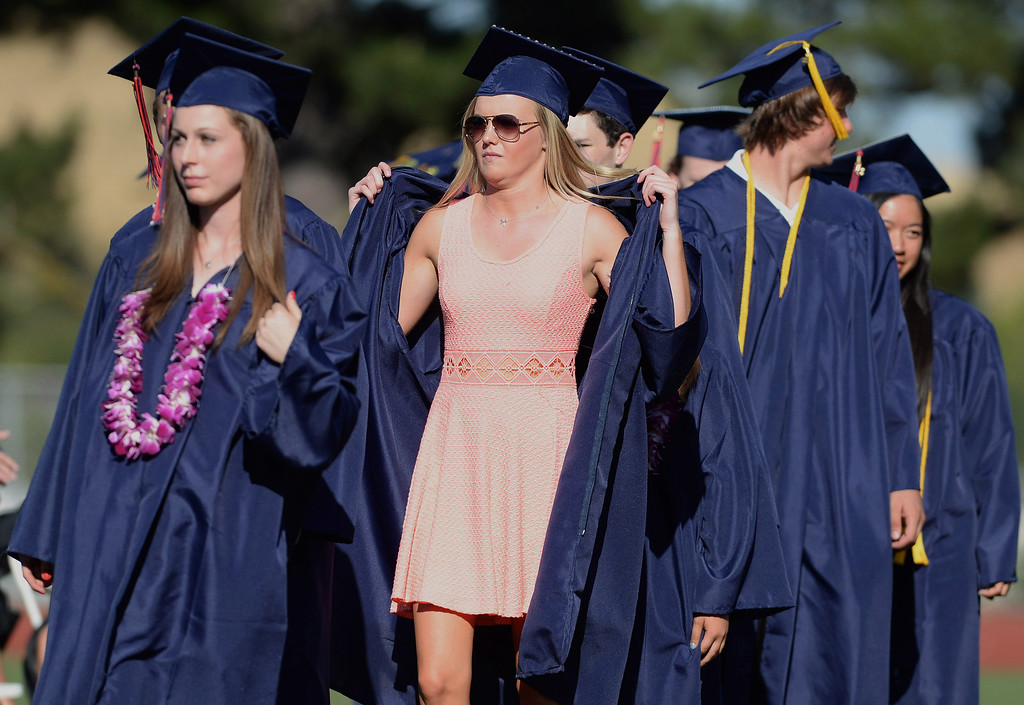 . Kendall Rolfe tries to keep cool at the 2013 Campolindo High School Commencement held on the Moraga, Calif., campus on Friday, June 7, 2013. (Dan Honda/Bay Area News Group)