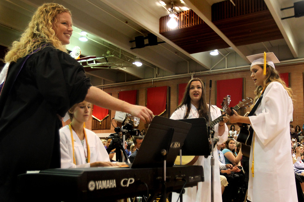 """. Carondelet High School Choral Director Amy Way, left, directs graduates Turner Wiley, piano, Kristina Waters and Emily Bjerke as they sing \""""Unwritten\"""" by Natasha Bedingfield during the commencement ceremony of the Class of 2013 at Carondelet High School in Concord, Calif., on Sunday, May 19, 2013. (Ray Chavez/Bay Area News Group)"""