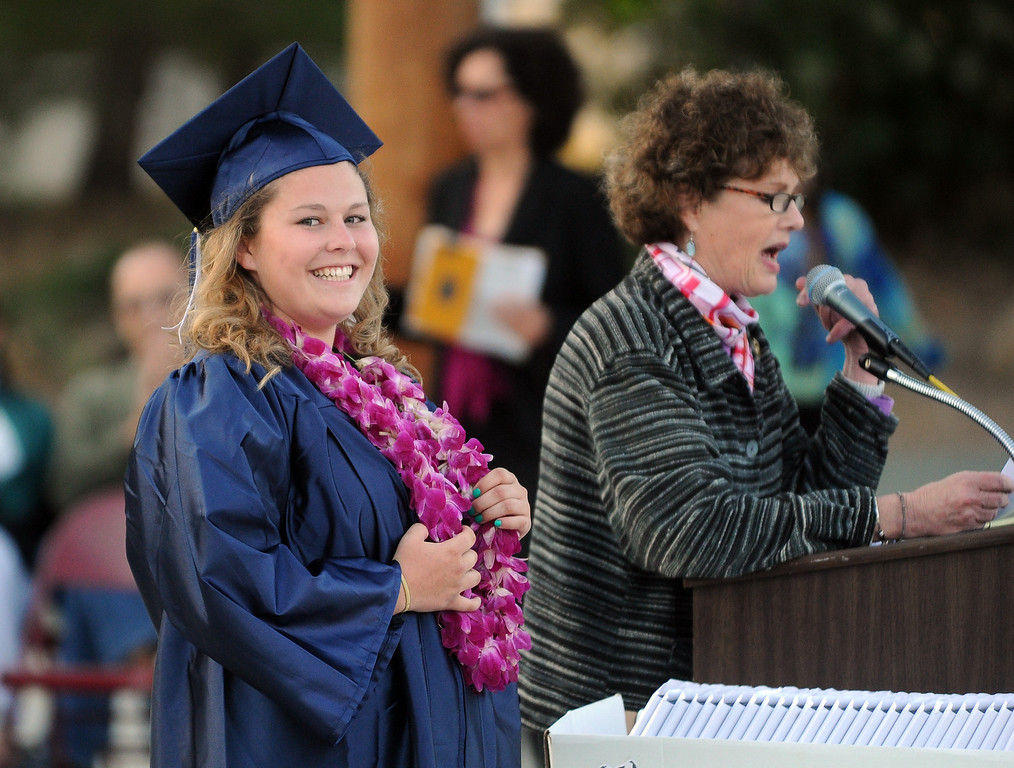 . Graduate Ashley Baughman, gets a scholarship from Beverly Gomer, from the Soroptimist International of Martinez, during the Vicente-Martinez High School and Briones School commencement ceremony in Martinez, Calif., on Wednesday, June 5, 2013. The graduation also featured class speeches by graduates Maalec Thomas and Serenity McGill, a performance by graduate Nicholas Napolitano and scholarship presentations by Martinez organizations. (Doug Duran/Bay Area News Group)