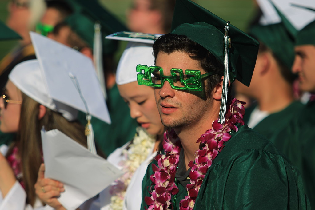 . A graduate wears class of 2013 glasses during Miramonte High School\'s 54th commencement ceremony in Orinda, Calif., on Friday, June 7,  2013. Graduates, friends and family endured very hot temperatures during the ceremony. (Jane Tyska/Bay Area News Group)