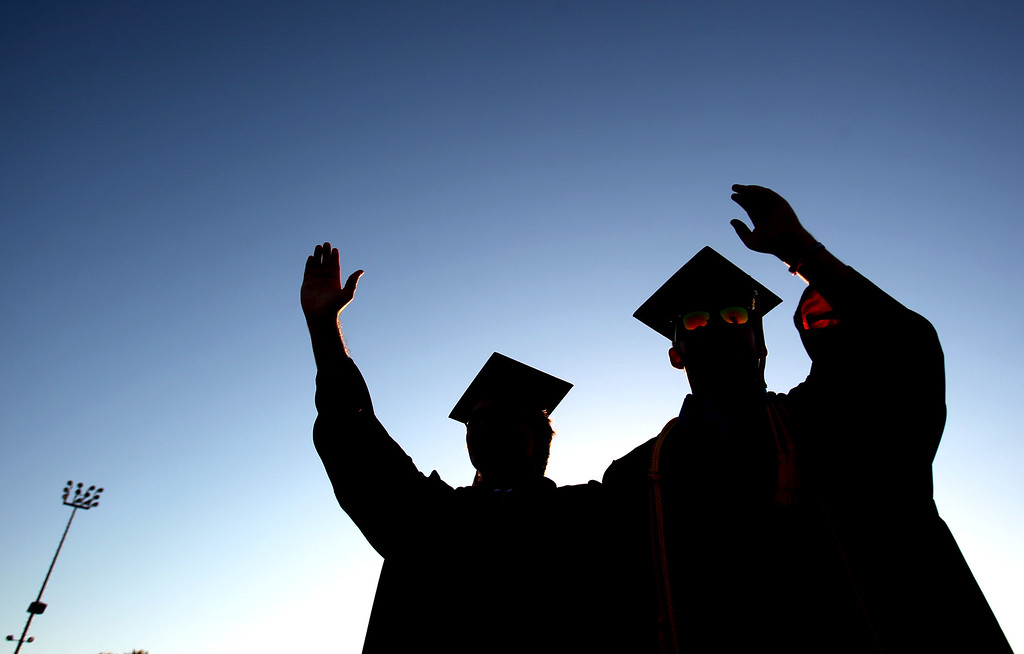 . Graduates and drum majors Kevin Johnson, 18, and Brett Harrison, 18, from left, lead the Liberty High School band following the Class of 2013 commencement ceremony on the school\'s Ohmstede Field in Brentwood, Calif., on Friday, June 7, 2013. (Anda Chu/Bay Area News Group)
