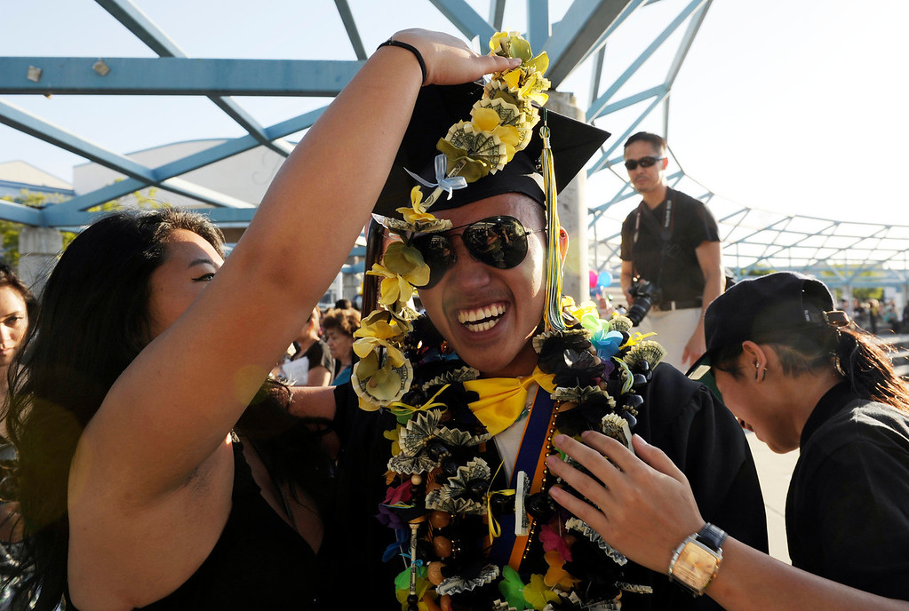. Christopher Ubando of Antioch celebrates with family and friends following his Dozier-Libbey Medical High School 2013 Commencement Ceremony held at Deer Valley High School in Antioch, Calif., on Wednesday, June 5, 2013. (Susan Tripp Pollard/Bay Area News Group)