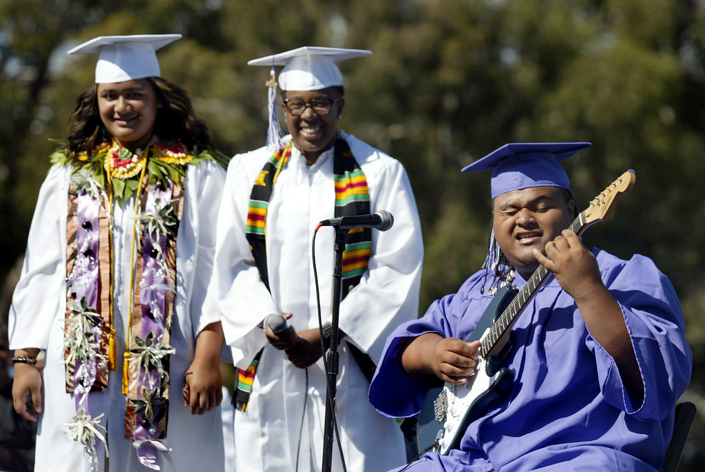 """. Seniors Ana Katoa, left, Dawn McCladdie and Westsomi Lapota sing \""""Look How Far We\'ve Come\"""" during the Castlemont High School graduation ceremony of the Class of 2013 in Oakland, Calif., on Friday, June 14, 2013. (Ray Chavez /Bay Area News Group)"""