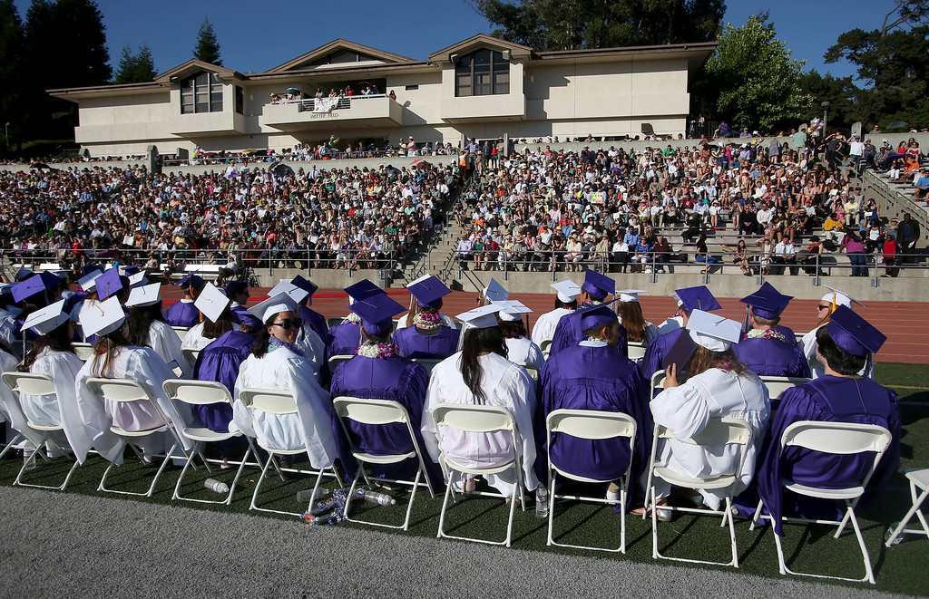 . The class of 2013 prepares to receive their diplomas during commencement ceremonies at Piedmont High School in Piedmont, Calif., on Thursday, June 13, 2013.  (Jane Tyska/Bay Area News Group)