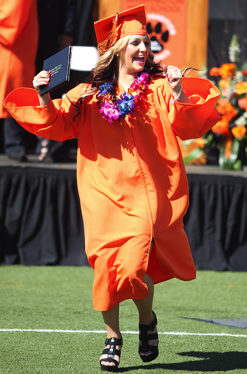 . McKenzie Lebon, 17, Washington High School Class of 2013 graduate celebrates after receiving her diploma during the school\'s commencement ceremony in Fremont, Calif., on Wednesday, June 19, 2013. (Anda Chu/Bay Area News Group)