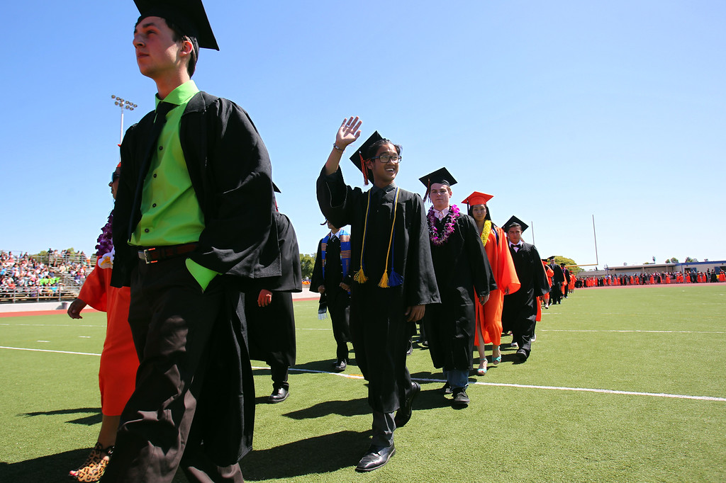 . Washington High School Class of 2013 graduates march into their commencement ceremony in Fremont, Calif., on Wednesday, June 19, 2013. (Anda Chu/Bay Area News Group)