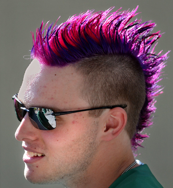 . San Ramon Valley High School graduate Daniel Jensen, 18, sports a purple mohawk as he waits for the start of the school\'s Commencement Ceremony in Danville, Calif., on Friday, June 14, 2013. (Doug Duran/Bay Area News Group)