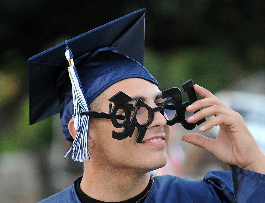 """. Graduate Timothy Fleming, wears novelty \""""grad\"""" glasses during the commencement ceremony for Vicente-Martinez High School and Briones School in Martinez, Calif., on Wednesday, June 5, 2013. The graduation also featured class speeches by graduates Maalec Thomas and Serenity McGill, a performance by graduate Nicholas Napolitano and scholarship presentations by Martinez organizations. (Doug Duran/Bay Area News Group)"""