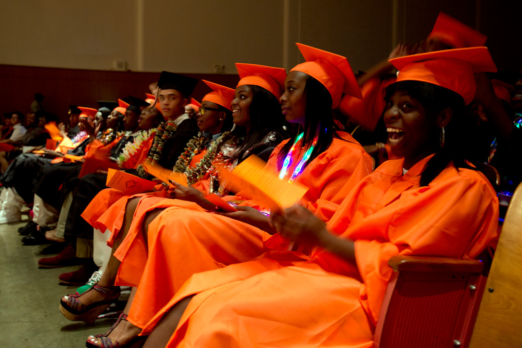 . Members of the Class of 2013 laugh as they watch a slideshow of their classmates during graduation ceremonies at McClymonds High School, Thursday, June 13, 2013 in Oakland, Calif. (D. Ross Cameron/Bay Area News Group)