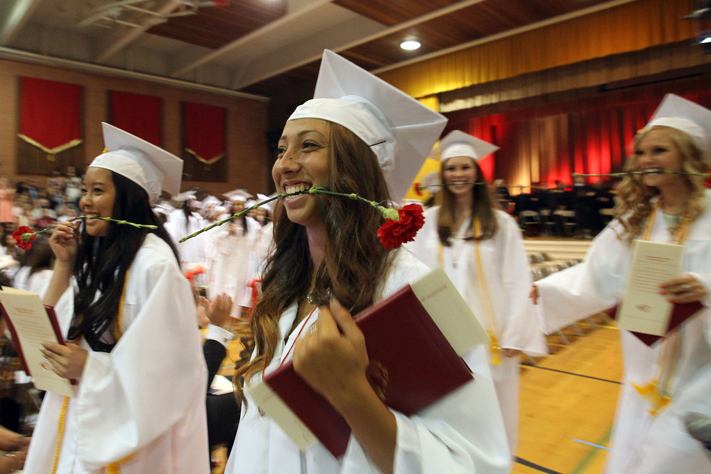 . Carondelet High School graduates of the Class of 2013 walk out of the gym at the conclusion of their commencement ceremony at Carondelet High School in Concord, Calif., on Sunday, May 19, 2013. (Ray Chavez/Bay Area News Group)