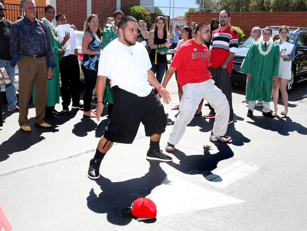 . Oliva Avimatagi, left, and Tautalatasi, both of San Francisco, do a  ceremonial Haka in honor of De La Salle graduate Pepe Vitale, not pictured, followed by the Commencement ceremony of the Class of 2013 at De La Salle High School , Calif., on Sunday, May 19, 2013. (Ray Chavez/Bay Area News Group)
