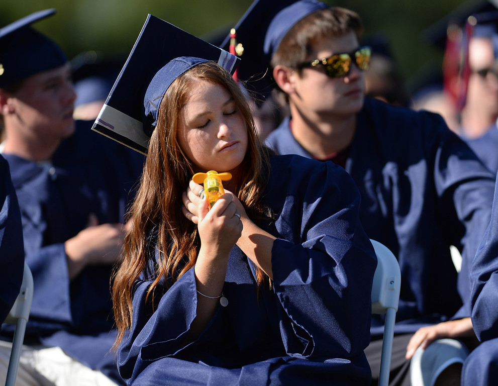 . On a very hot evening, graduates did what they could to keep cool at the 2013 Campolindo High School Commencement held on the Moraga, Calif., campus on Friday, June 7, 2013. (Dan Honda/Bay Area News Group)