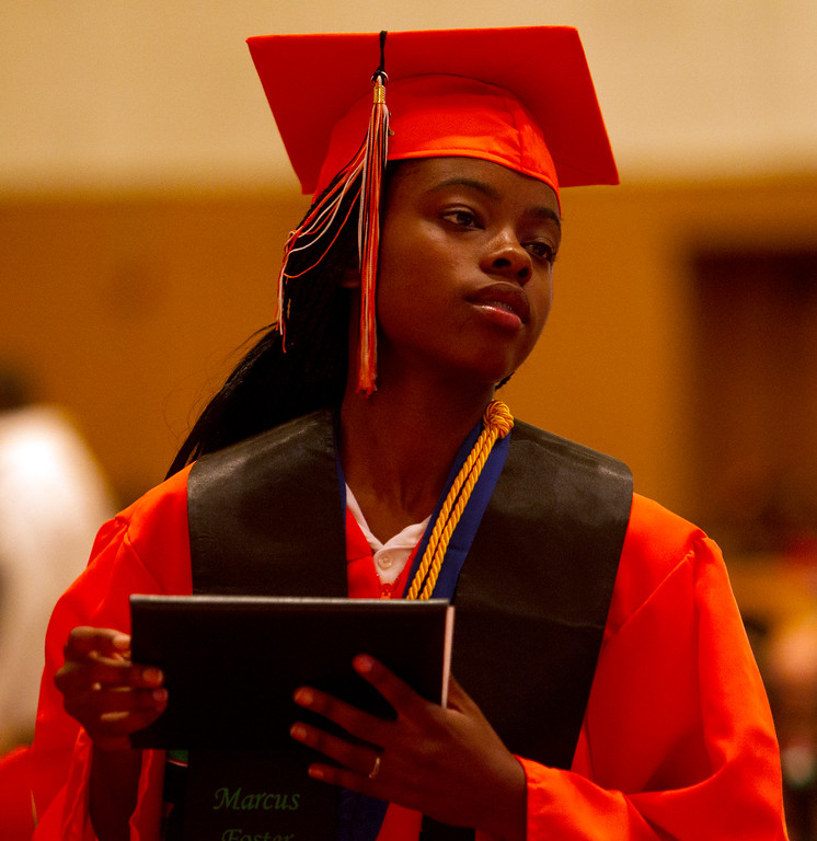 . Valedictorian Iakiriyya Karimusha holds her diploma during the graduation ceremonies for the Class of 2013 at McClymonds High School, Thursday, June 13, 2013 in Oakland, Calif. (D. Ross Cameron/Bay Area News Group)