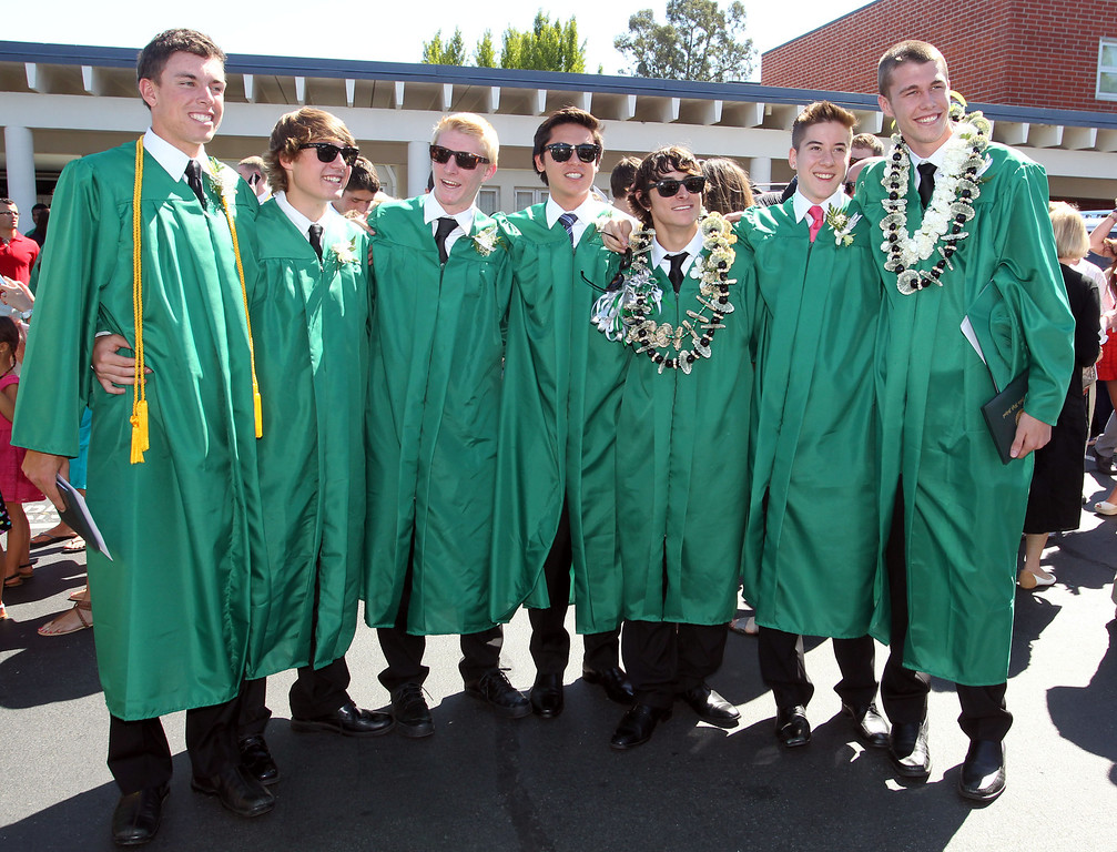 . De La Salle graduates of the Class of 2013 have their picture taken by family members and friends following their commencement ceremony at De La Salle High School in Concord, Calif., on Sunday, May 19, 2013. (Ray Chavez/Bay Area News Group)