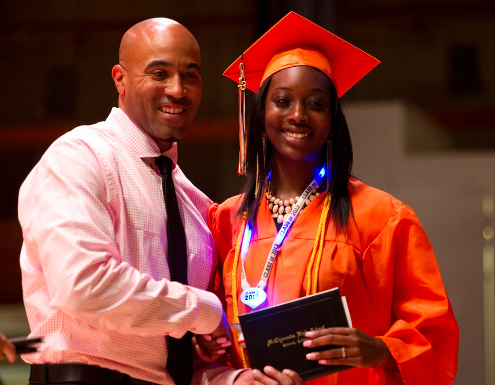 . Carmen Cummings, right, poses for a photograph with Principal Kevin Taylor during the graduation ceremonies for the Class of 2013 at McClymonds High School, Thursday, June 13, 2013 in Oakland, Calif. (D. Ross Cameron/Bay Area News Group)