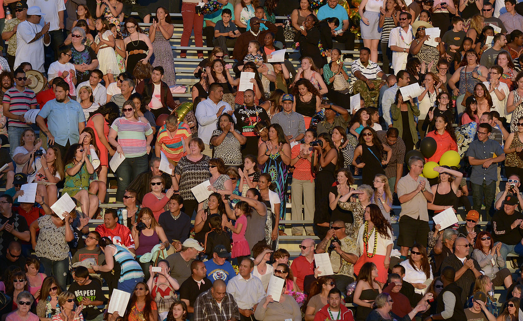 . Friends and family clap for their future graduates as they walk onto the field during graduation ceremonies at Antioch High School in Antioch, Calif., on Thursday, June 6, 2013. (Jose Carlos Fajardo/Bay Area News Group)