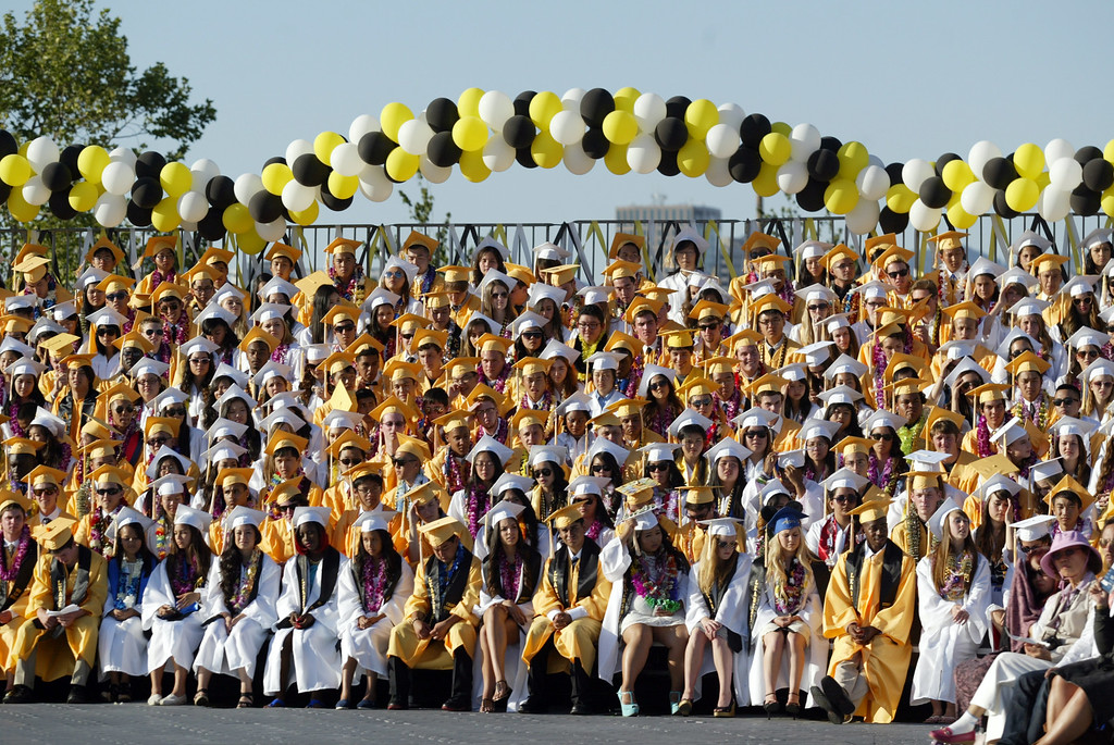 . Seniors of the Class of 2013 listen to speakers during the Alameda High School graduation ceremony at the College of Alameda soccer field in Alameda, Calif., on Friday, June 7, 2013.  (Ray Chavez / Bay Area News Group)