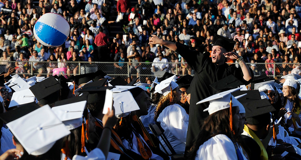 . A senior sends a beach ball flying during the 2013 commencement ceremony at Pittsburg High School in Pittsburg, Calif., Wednesday,  June 12, 2013. (Susan Tripp Pollard/Bay Area News Group)