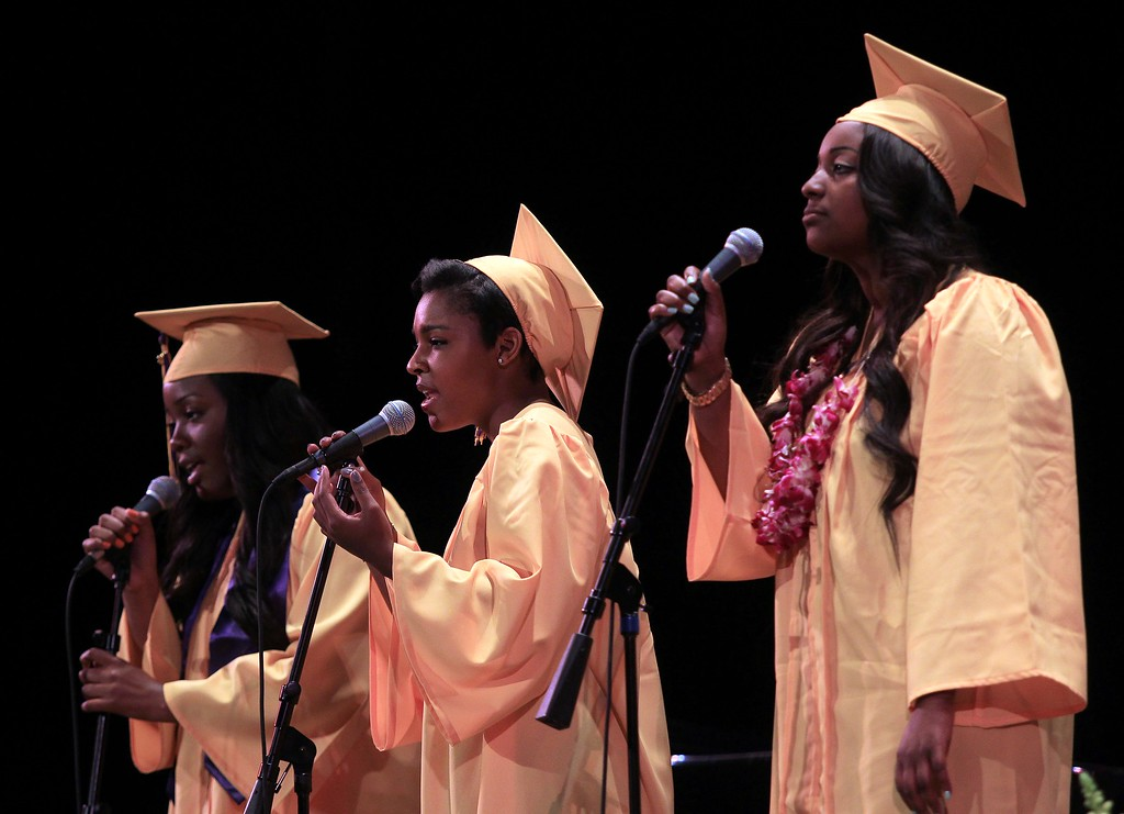 """. The Senior Quartet (fourth member not pictured playing piano) perform the song \""""Rare\"""" during Oakland Technical High School graduation ceremonies at the Paramount Theatre in Oakland, Calif., on Tuesday, June 11,  2013. Crystal Brooks, center, Meron Arefaome, Ida Jackson and Maiyah Phelps make up the quartet. (Jane Tyska/Bay Area News Group)"""