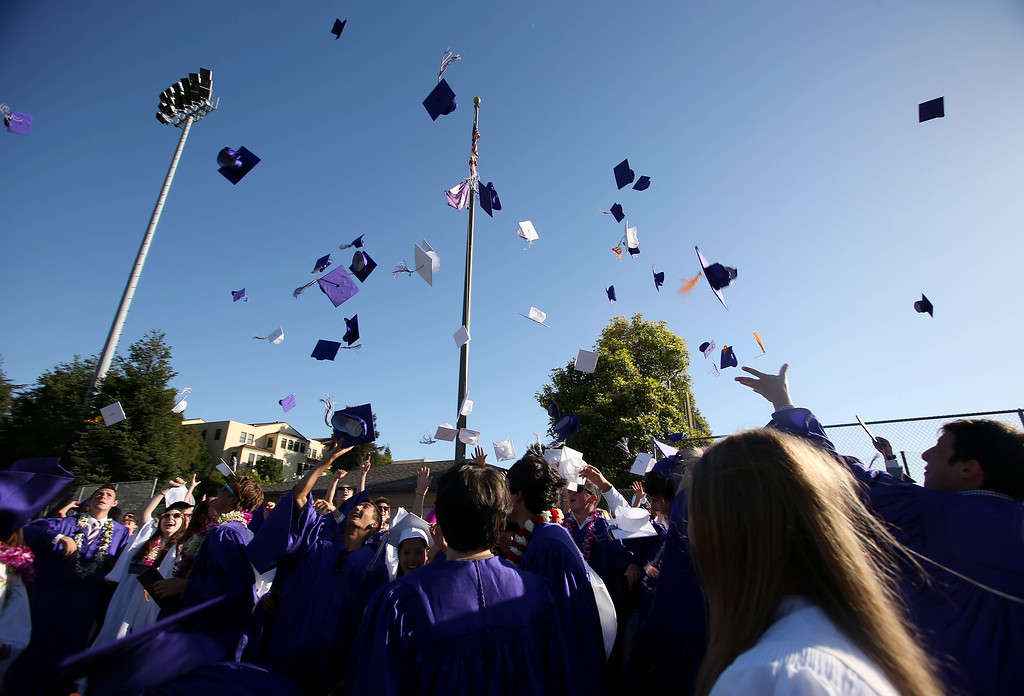 . The class of 2013 toss their caps at the conclusion of commencement ceremonies at Piedmont High School in Piedmont, Calif., on Thursday, June 13, 2013. (Jane Tyska/Bay Area News Group)