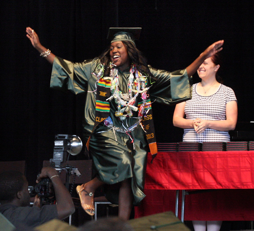 . Emani Jeanette Burks dances across the stage as she receives her diploma at the graduation ceremonies for Mt. Diablo High School held at the Sleep Train Pavilion in Concord, Calif., on Sunday, June 9, 2013. It is the 100th anniversary of the school,  which graduated three students in 1913 and 300 on Sunday. (Jim Stevens/Bay Area News Group)