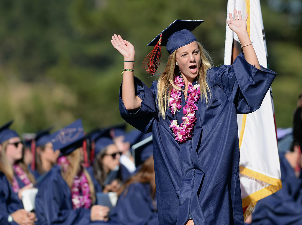 . Sarah Parsons reacts to screams from the crowd as she walks up to get her diploma at the 2013 Campolindo High School Commencement held on the Moraga, Calif., campus on Friday, June 7, 2013. (Dan Honda/Bay Area News Group)