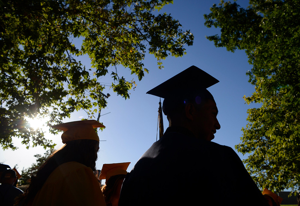. Ygnacio Valley High School student David Basulto, 18, waits outside for the start of commencement ceremonies at Sleep Train Pavilion in Concord, Calif., on Thursday, June 13, 2013. (Jose Carlos Fajardo/Bay Area News Group)