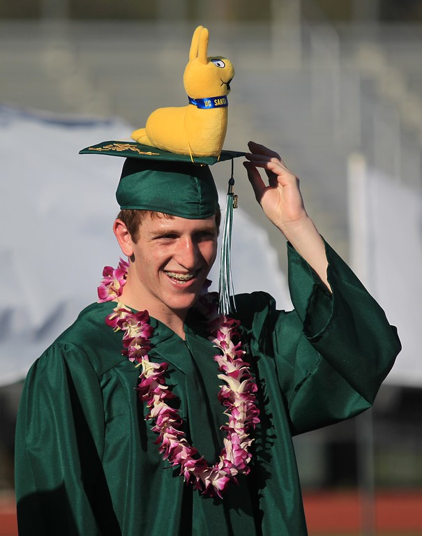 . Adam Brager adjusts his cap during Miramonte High School\'s 54th commencement ceremony in Orinda, Calif., on Friday, June 7, 2013. Brager wore a University of Santa Cruz slug on his cap, as he\'ll be attending there in the fall.  (Jane Tyska/Bay Area News Group)
