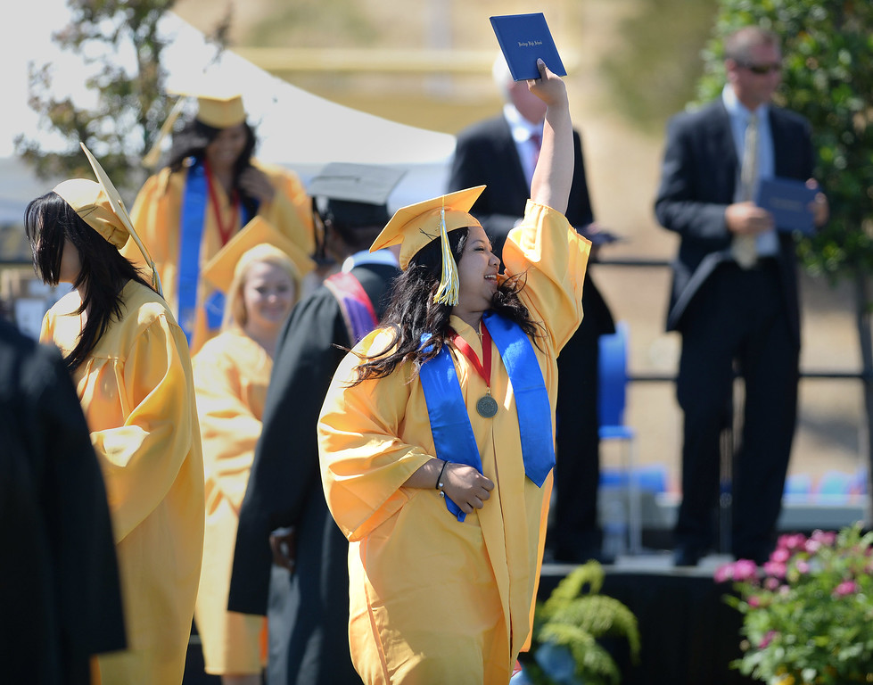 . Alianah Magalued acknowledges cheers from loved ones in the stands at the Heritage High School graduation ceremony held at Patriot Stadium on the campus of Heritage High School in Brentwood, Calif., on Saturday, June 8, 2013. (Dan Honda/Bay Area News Group)
