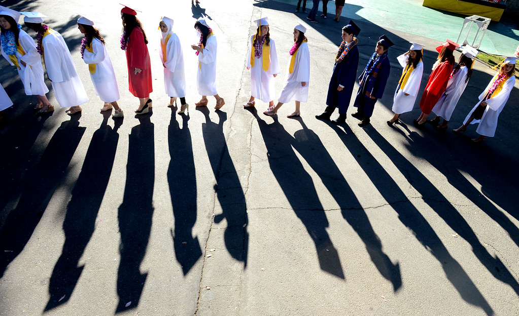 . Dublin High graduates walks into the amphitheater for the start of their Commencement Ceremony held at the Alameda County Fairgrounds in Pleasanton, Calif., on Thursday, June 13, 2013. (Doug Duran/Bay Area News Group)