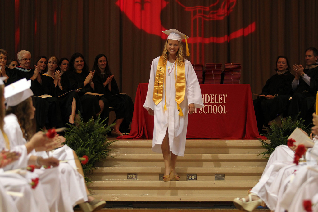 . Valedictorian Alyssa McHugh receives applause after her speech to friends, family members and classmates of Carondelet High School Class of 2013 during their commencement ceremony at Carondelet High School in Concord, Calif., on Sunday, May 19, 2013. (Ray Chavez/Bay Area News Group)