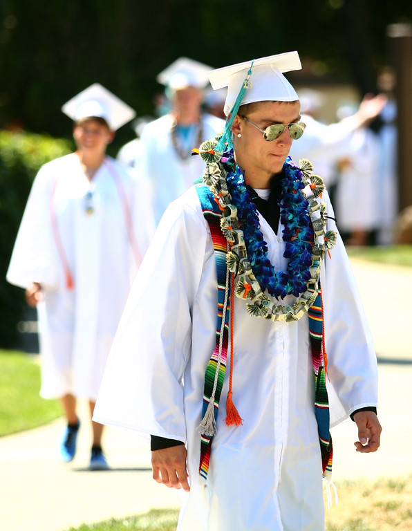 . Class of 2013 graduate Carlos Lopez, 19, marches to his graduation ceremony at the California School for the Deaf in Fremont, Calif., on Friday, June 7, 2013. Forty seniors make up the school\'s 141st CSD graduating class. (Anda Chu/Bay Area News Group)