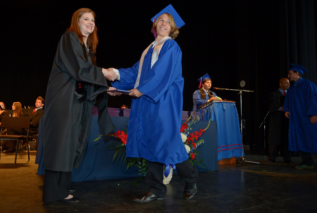 . Clayton Valley Charter High School teacher Christine Reimer hands a diploma cover to student Sage Jensen during commencement ceremonies on Thursday, May 30, 2013 at Sleep Train Pavilion in Concord, Calif. (Jose Carlos Fajardo/Bay Area News Group)