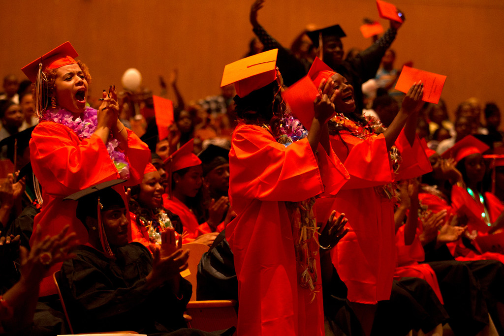 . Graduates cheer their classmates during the commencement exercises for the Class of 2013 at McClymonds High School, Thursday, June 13, 2013 in Oakland, Calif. (D. Ross Cameron/Bay Area News Group)