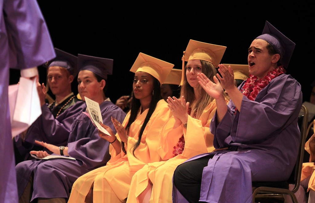 . Students applaud class valedictorian Kieran Annett after he speaks at Oakland Technical High School graduation ceremonies at the Paramount Theatre in Oakland, Calif., on Tuesday, June 11,  2013. The school graduated 351 students  in the class of 2013. (Jane Tyska/Bay Area News Group)