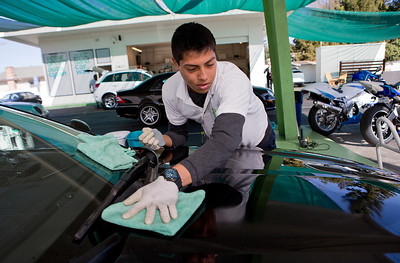 Juan Garcia wipes a car that he cleans with EcoGreen Auto Clean Auto Wash at EcoGreen Auto Clean, in Redwood City, Calif., on Friday, January 31, 2014.  (LiPo Ching/Bay Area News Group)
