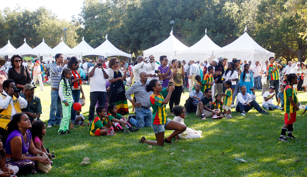 ". Crowd watches performance by local band, "" Young Ethio Jazz Band\"",  during the Ethiopian \""Enkutatash\""  new year celebration at Guadalupe River Park Arena Green West in downtown San Jose, Calif.,  on Sunday, Sept. 8, 2013. (Josie Lepe/Bay Area News Group)"