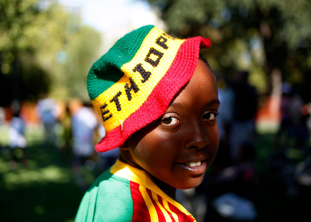 ". Santa Clara resident Natnaiel Yishak, 10, poses for the camera during  the Ethiopian ""Enkutatash\"" new year celebration at Guadalupe River Park Arena Green West in downtown San Jose, Calif.,  on Sunday, Sept. 8, 2013. (Josie Lepe/Bay Area News Group)"